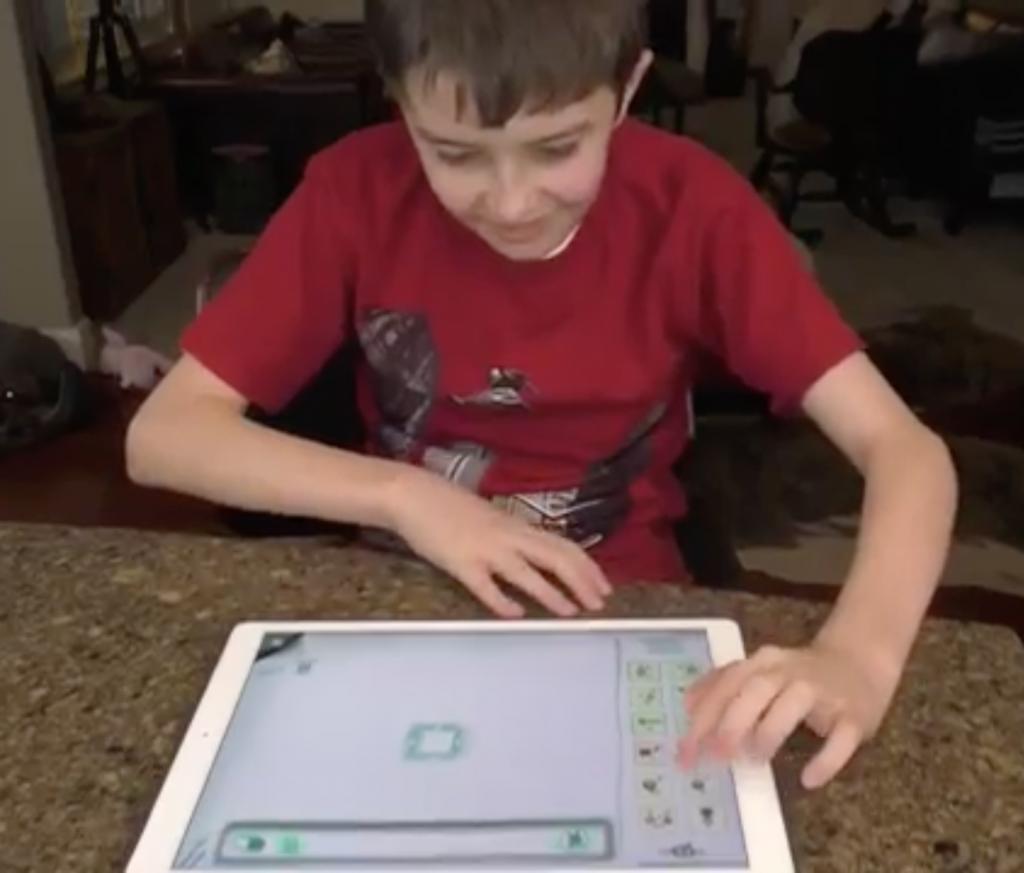 Child using Avaz FreeSpeech