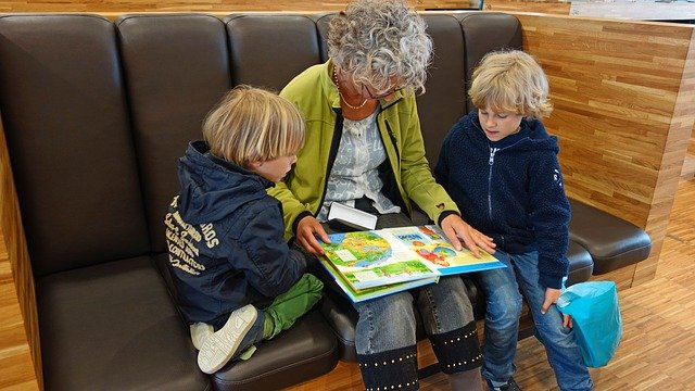 Grandmother reading wordless picture books AAC learners
